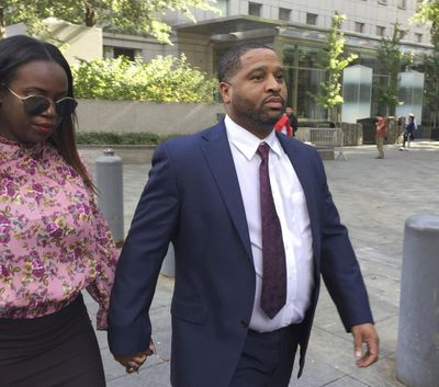 In this Oct. 10, 2017,  photo, University of Arizona assistant men's basketball coach Emanuel Richardson leaves Manhattan federal court in New York. Richardson, no longer with the team, is expected in federal court, Tuesday, Jan. 22, 2019, for a development in a criminal case in which he is charged with taking bribes from a sports agent. (Larry Neumeister / Associated Press)