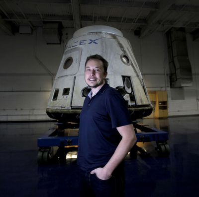 Telsa and SpaceX founder Elon Musk stands in front of the SpaceX Dragon capsule at Space Exploration Technologies Corp. Neuralink Corp. (Tribune News Service)
