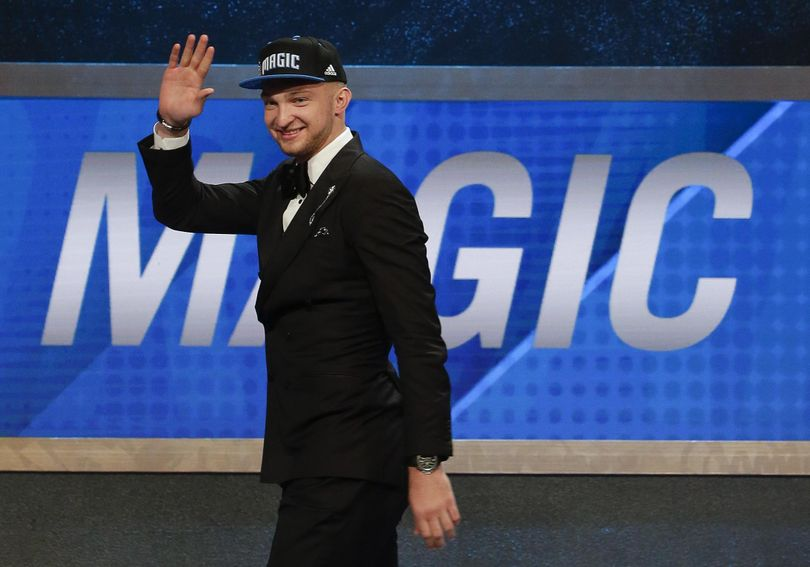 Domantas Sabonis waves as he walks off stage after being selected 11th overall by the Orlando Magic during the NBA basketball draft. The Magic traded Sabonis to Oklahoma City. (Frank Franklin II / Associated Press)