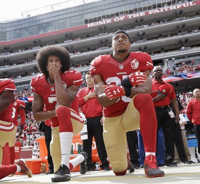 FILE - In this Oct. 2, 2016 file photo, San Francisco quarterback Colin Kaepernick, left, and safety Eric Reid kneel during the national anthem before an NFL football game against the Dallas Cowboys in Santa Clara, Calif. Reid, currently a free agent, said he doesn't plan to kneel during the national anthem during the 2018 season. (Marcio Jose Sanchez / Associated Press)