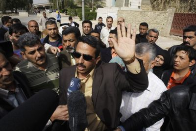 Odei al-Zeidi, center, brother of Iraqi journalist Muntadhar al-Zeidi, who gained cult status for throwing his shoes at President George W. Bush last year, talks to media outside court Thursday as his brother was brought to a hearing in Baghdad.  (Associated Press / The Spokesman-Review)