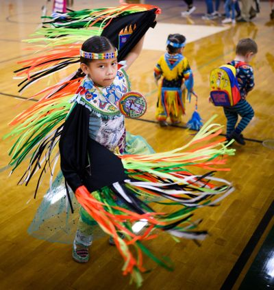 Celebrating Indigenous Peoples Day, Davianna Madera, 7, joins other dancers during a powwow on Monday, Oct. 14, 2019, at the Warehouse sports center on North Hamilton Street in Spokane. (Colin Mulvany / The Spokesman-Review)