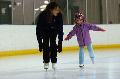 Skating instructor Brenda Tarkinton watches as Courtney Wycoff, 4, regains her balance during a recent lesson at Planet Ice.   (Liz-Anne Kishimoto / The Spokesman-Review)