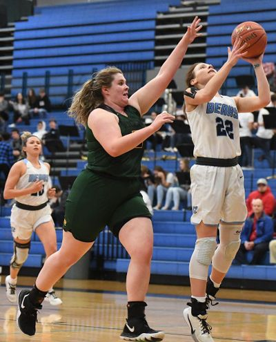 Central Valley's Grace Geldien (22) lays in the ball during the District 8 4A high school basketball playoffs on Wednesday, Feb. 12, 2020, at Central Valley High School in Spokane Valley, Wash. (Tyler Tjomsland / The Spokesman-Review)