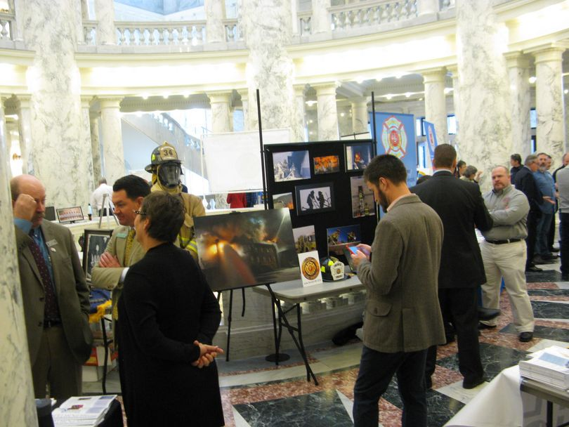Union leaders from across the state set up booths in the state Capitol rotunda on Thursday afternoon and reached out to lawmakers (Betsy Z. Russell)
