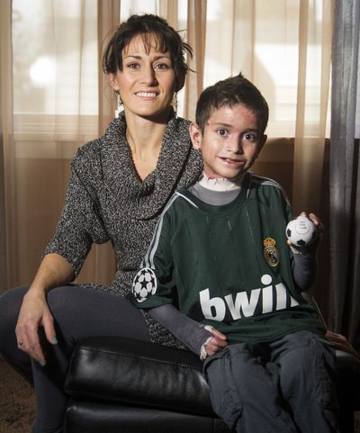 Saml Diaz, 8, has a rare genetic disorder. He joined a soccer team this year, but because of his disorder, can't play much in the game. He and his mom, Allison Diaz, sold stress balls to help raise funds to find a cure. (Colin Mulvany)
