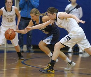 Gonzaga Prep's Laura Stockton, center, and Mead's Coreen Labish, right, chase a rebound across the floor Tuesday, Dec. 17, 2013 at Mead High School.  Delany Junkermier looks on at left. (Jesse Tinsley / The Spokesman-Review)