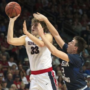 BYU guard Zac Seljaas tries to stop a shot by Gonzaga Bulldogs forward Kyle Wiltjer (33) during the first half of Monday's WCC semifinal in Las Vegas. (Colin Mulvany / The Spokesman-Review)