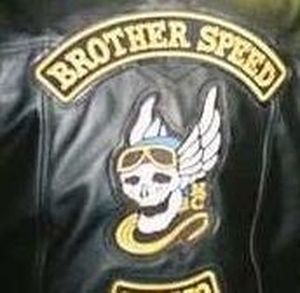 Brother Speed Motorcycle Club's logo features a grinning skull