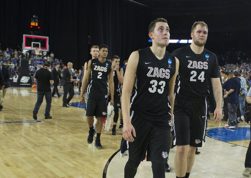Gonzaga forward Kyle Wiltjer (33) looks up at the scoreboard one last time and exits the court with Gonzaga center Przemek Karnowski (24) after Duke beat the Zags 66-52, Sunday, March 29, 2015, in Houston, Texas. COLIN MULVANY colinm@spokesman.com    (Colin Mulvany)