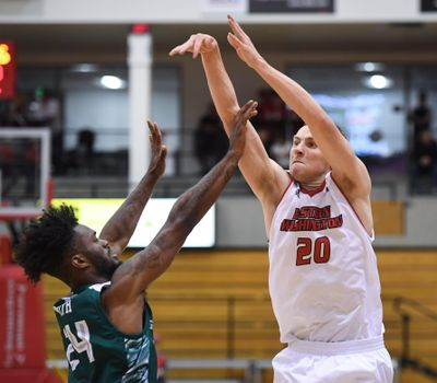 Eastern Washington guard Cody Benzel fires up a 3-pointer over Wisconsin-Green Bay guard Jevon Smith on  Nov. 16, 2018, in Cheney. (Dan Pelle / The Spokesman-Review)