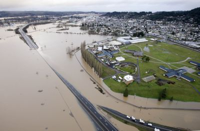 Interstate 5 is submerged by flood waters from the Chehalis River on Thursday in Chehalis, Wash.  (Associated Press / The Spokesman-Review)
