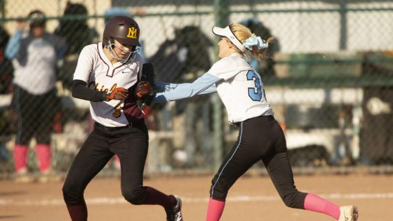 A Central Valley player, right, gets the final out against Moses Lake in a 4A state slowpitch softball semifinal game on Friday, Nov. 1, 2019, in Yakima, Wash. (Evan Abell / Yakima Herald-Republic)