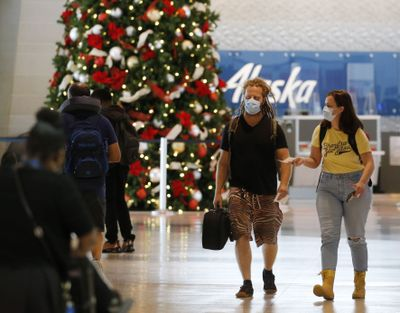 Passengers make their way through the airport near the security checkpoint at Dallas Love Field airport in Dallas on Nov. 10, 2020. Airline passenger satisfaction is at an all-time high for the airline industry, according to the American Customer Satisfaction Index study for April to September.  (Tribune News Service)