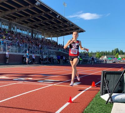 North Central's Allie Janke crosses the finish line to win the State 3A girls 1,600-meter race on Thursday in Tacoma. (@wiaawa / Twitter)