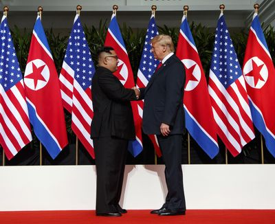 In this June 12, 2018 photo, North Korean leader Kim Jong Un, left, and U.S. President Donald Trump shake hands prior to their meeting on Sentosa Island in Singapore. (Evan Vucci / Associated Press)