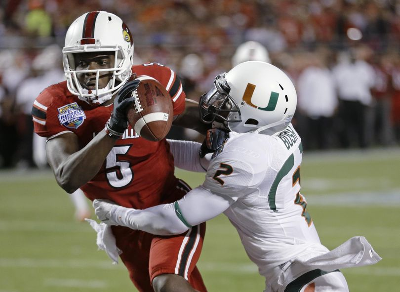 Miami safety Deon Bush, right, is know for his physical style of play.