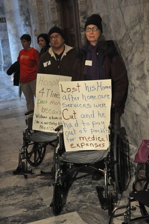 OLYMPIA--Members of the SEIU protest proposed budget cuts outside the governor's office on 12/15/2010. (Jim Camden/The Spokesman-Review)
