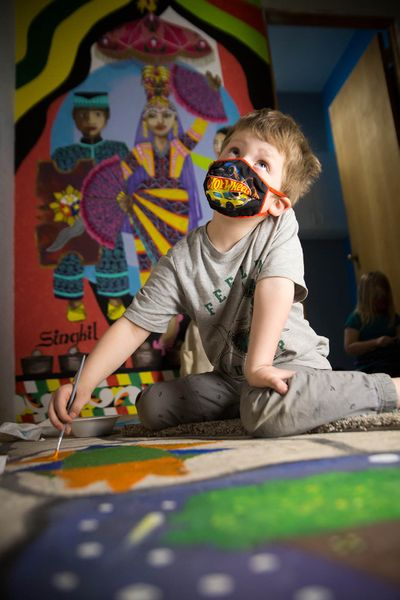 Garfield Elementary kindergartner Lincoln Vaneenoo paints on the floor of the new Spokane artists collective Make a Difference Co. Lab Studios, or M.A.D., at 3038 E. Trent Ave., on Thursday.  (Libby Kamrowski/The Spokesman-Review)