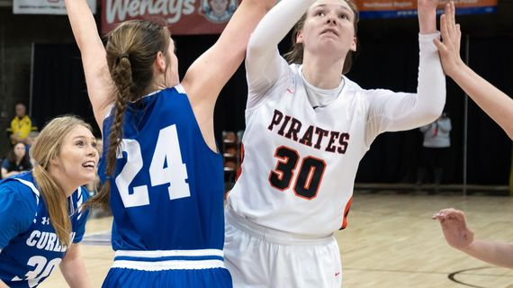 Pomeroy point guard Maddy Dixon  lines up a shot as Curlew forward Korin Baker  defends during a State 1B quarterfinal Thursday  in the Spokane Arena. (Colin Mulvany / The Spokesman-Review)