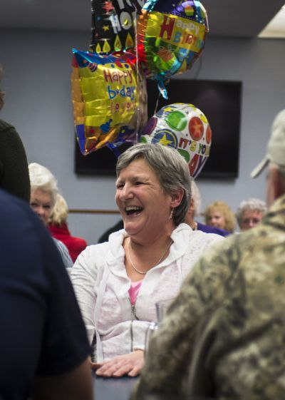 Kim Varner celebrates her 50th birthday at a surprise party with friends and family at Five Mile Heights Pizza on Jan. 29. Varner wasn't sure she would live to see 50 because of breast cancer. (Colin Mulvany)