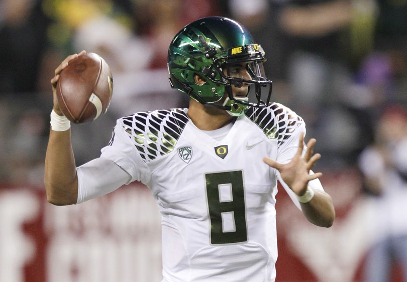 Oregon quarterback Marcus Mariota looks to pass against Washington State in the first half of an NCAA college football game, Saturday, Sept. 29, 2012, in Seattle. (Ted Warren / Associated Press)