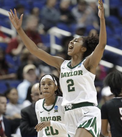 Baylor's DiDi Richards  reacts after a basket against South Carolina during Saturday's  NCAA Tournament game in Greensboro, N.C. (Chuck Burton / AP)