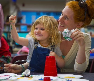 "Harley, 2, and Reagan Rufner participate in painting time in the 1-2-3- Grow & Learn program in the library at Roosevelt Elementary on May 20, 2018, in Vancouver, Wash. As student poverty rates soared in ""America's Vancouver,"" school officials converted more than half of the district's campuses into one-stop shops for low-income and homeless families. (Mike Siegel / Seattle Times)"