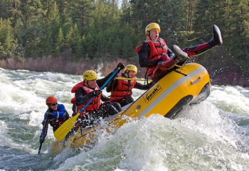 A Peak 7 Adventures groups rafts down the Spokane River. (Courtesy photo)