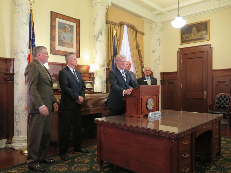 Gov. Butch Otter, joined by GOP legislative leaders, discusses Idaho's just concluded legislative session on Thursday, March 29, 2018, at the Idaho state Capitol. (The Spokesman-Review / Betsy Z. Russell)
