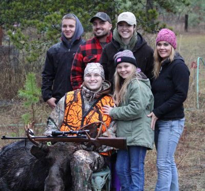 Jace Malek's family celebrates his successful moose hunt organized for youth with life-threatening illness. (Courtesy)