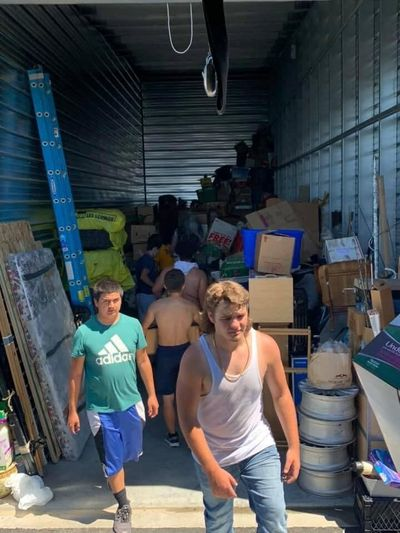 The Rogers High School football team helped a woman move her items from a storage unit on June 28 in triple-digit heat.  (Courtesy Matt Miethe)