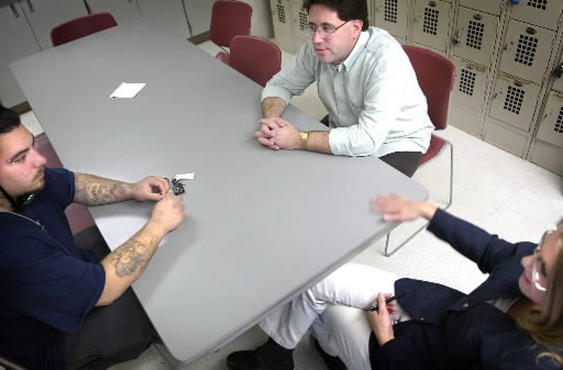 Parolee Victor Luna, left, listens to his mentors Tom Murphy and Suellen Pritchard during a weekly meeting to help Luna adjust to life outside of prison on Oct. 27, 2005. Luna is a participant in the Going Home program, the Washington State Re-entry Project. (The Spokesman-Review)