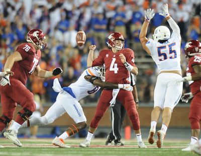 Washington State Cougars quarterback Luke Falk (4) is sacked by Boise State Broncos defensive end Jabril Frazier (8) and fumbles the ball which Boise State recovered for a touchdown during the second half of a college football game on Saturday, September 9, 2017, at Martin Stadium in Pullman, Wash. (Tyler Tjomsland / The Spokesman-Review)