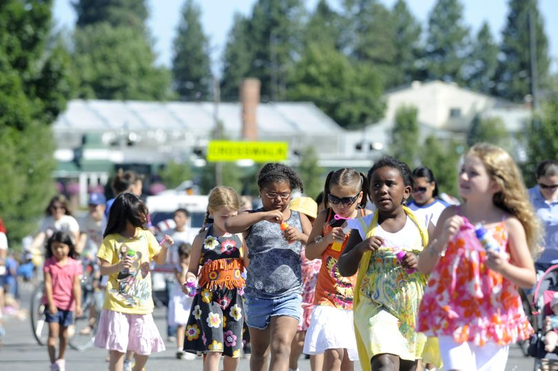 Students from the Liberty Park Child Development Center march down Perry Street during the South Perry Parade and Fair Saturday, July 16, 2010. (Jesse Tinsley / The Spokesman-Review)