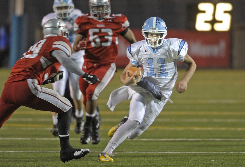 Central Valley quarterback Gaven Deyarmin breaks into the open against Ferris for a long gain. Deyarmin finished with 91 yards rushing. (Christopher Anderson)