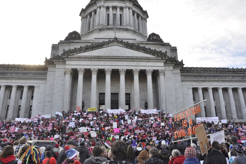 OLYMPIA -- A crowd of demonstrators, estimated by state officials at about 5,500, gather on the steps of the Capitol to demand more money for public schools on 1/16/17. (Jim Camden/The Spokesman-Review)