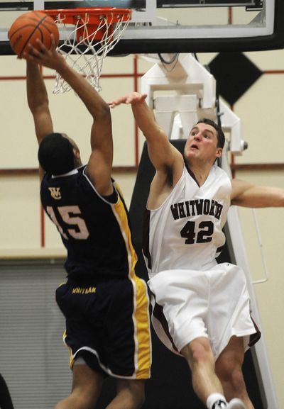 Whitworth's Jack Loofburrow thwarts a dunk attempt by Whitman's David Michaels on Tuesday. (Dan Pelle / The Spokesman-Review)