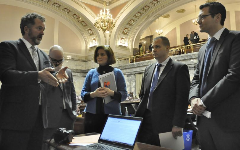 OLYMPIA – Sen. Kevin Ranker, far left, tries to make a point to Sen. Joe Fain, R-Auburn, as Sens. John Braun and Christina Rolfes and Senate Democratic spokesman Aaron Wasser look on. Some senators engaged in a contentious debate over school funding measures at the press table on March 6 even though the Senate had adjourned for the day. (Jim Camden / The Spokesman-Review)