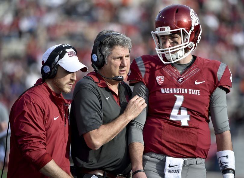 Washington State head coach Mike Leach speaks with quarterback Luke Falk (4) against Oregon State during the second half of a PAC 12 football game on Saturday, Oct 17, 2015, at Martin Stadium in Pullman, Wash.  TYLER TJOMSLAND tylert@spokesman.com (Tyler Tjomsland / The Spokesman-Review)