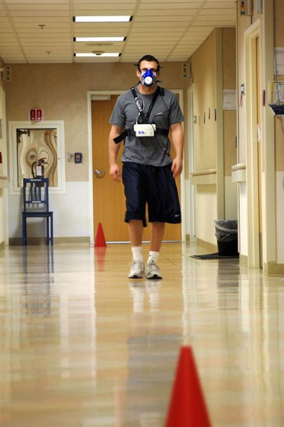 A volunteer walks a hallway wearing instruments that measure oxygen consumption. The 50-year-long Baltimore Longitudinal Study of Aging has provided invaluable data on the aging process. Washington Post (Washington Post / The Spokesman-Review)
