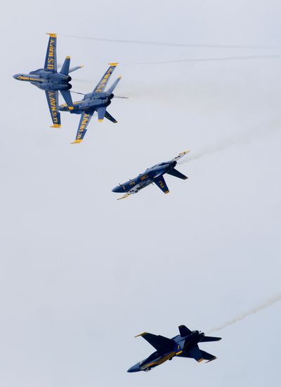 Flying F/A-18 Hornets, the U.S. Navy's Blue Angels perform precision aerobatic maneuvers at the Barksdale Air Force Base Defenders of Liberty Air Show on May 10 in Barksdale, La. The (Shreveport) Times (Henrietta WIldsmith The (Shreveport) Times / The Spokesman-Review)