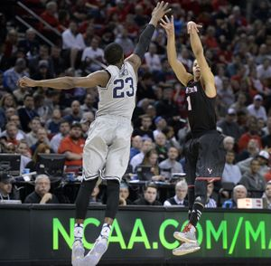 Eastern Washington University 's Tyler Harvey fires a 3-point shot over Georgetown's Aaron Bowen  during their 2015 NCAA Men's Basketball championship second round game against Georgetown, March 19, 2015, in Portland, Ore. (The Spokesman-Review)
