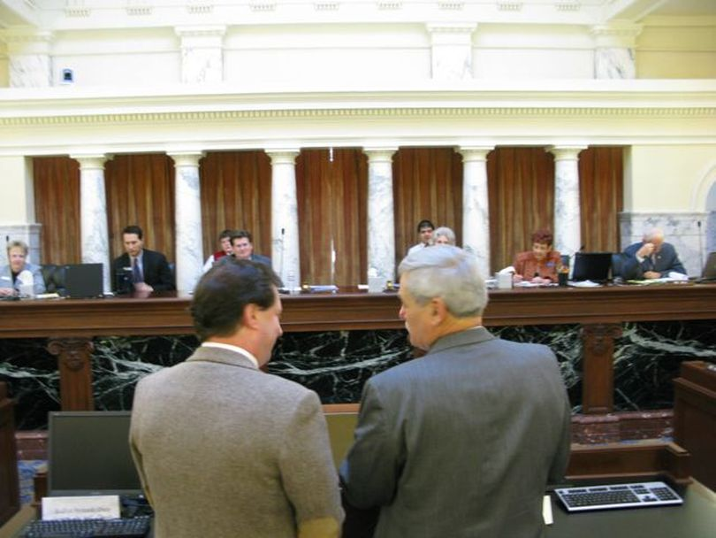Rep. Cliff Bayer, left, and Sen. John Goedde, right, present the Legislature's joint Economic Outlook & Revenue Assessment Committee's projections to JFAC on Friday. (Betsy Russell)