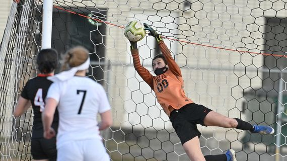 West Valley goalkeeper Madison Maloney dives for one of six saves against visiting Clarkston on March 4, 2021 in a 2021 Greater Spokane League 2A game. West Valley won 4-3 in a shootout.  (Dirk Linton/courtesy)