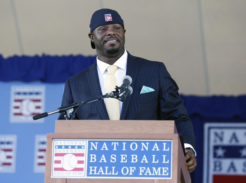 National Baseball Hall of Fame inductee Ken Griffey Jr. concludes his remarks at Sunday's induction ceremony in Cooperstown, New York. (Mike Groll / Associated Press)