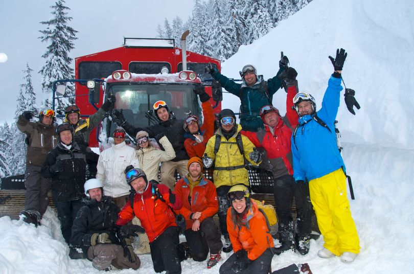 Carey and Ryan Stanley of Coeur d'Alene, front center, pose with a group of clients with their Silver Valley snowcat skiing operation, Peak Adventures. (Courtesy photo)