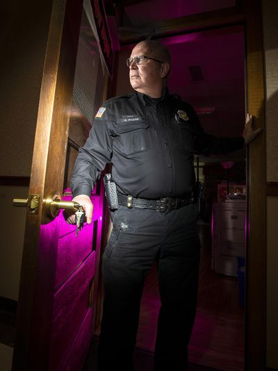 "School Resource Officer Walt Pegram with Spokane Public Schools shows off a newly installed ""Columbine Lock"", which allow teachers to lock people out during a school emergency, while also allowing students to get out anytime. (Colin Mulvany / The Spokesman-Review)"
