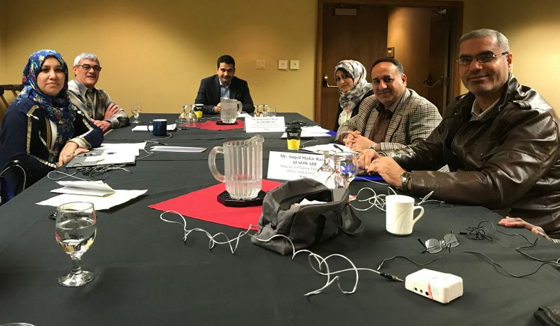 A delegation of government and financial officials from Iraq, joined by, second from left, Mowbray Brown, a board member of the Idaho Council for International Visitors, meets in Boise on Tuesday, April 17, 2018. (The Spokesman-Review / Betsy Z. Russell)