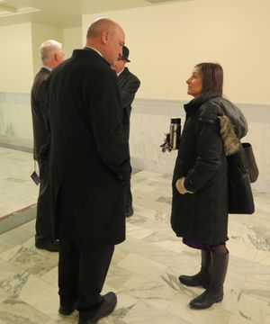 Rep. Heather Scott, right, visits with new House Ethics Committee Chairman Van Burtenshaw, R-Terreton, in a friendly exchange in a Capitol corridor before leaving the Statehouse on Wednesday evening. (Betsy Z. Russell)